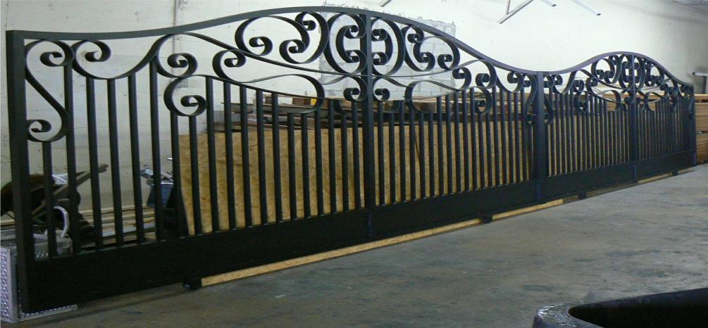 This Large Double Driveway Gate using the Sophie Design with an over all width of 32 feet, These gates are Rolling Gates and were made Automatic